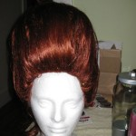 ... and then do the sides. Wherever your wig has a part, this smoothed hair will want to open up - take extra care to hairspray and then comb that hair together. Hairspray some more.
