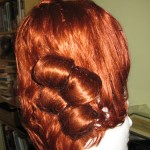 Attach the curls you've made to the wig using bobby pins in X shapes. This was my attempt at fat curls, and I did two side by side. When I switched to narrower curls, I was able to get one long length of curl, which I thought looked better.  Look at period illustrations for other options for adding extra hair, including back curls and the long, pinned up ponytails you sometimes see.  I think it's time for some more hairspray, what do you think?
