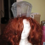 Sew the form to the wig using standard sewing thread and a big needle.