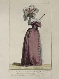 """1787 fashion plate from Gallerie des Modes: """"Jeune Dame rêvant au doux mistere: elle est vêtue d'une jolie rodingotte à boutons d'acier et un chapeau à la Contat."""" Museum of Fine Arts, Boston."""