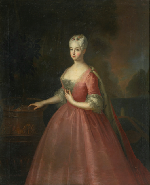 Circle of Antoine Pesne | PORTRAIT OF FRIEDERIKE LUISE, MARGRAVINE OF ANSBACH (1714 – 1784), THREE-QUARTER LENGTH, WEARING A PINK DRESS AND STANDING IN A WALLED GARDEN | Sotheby's