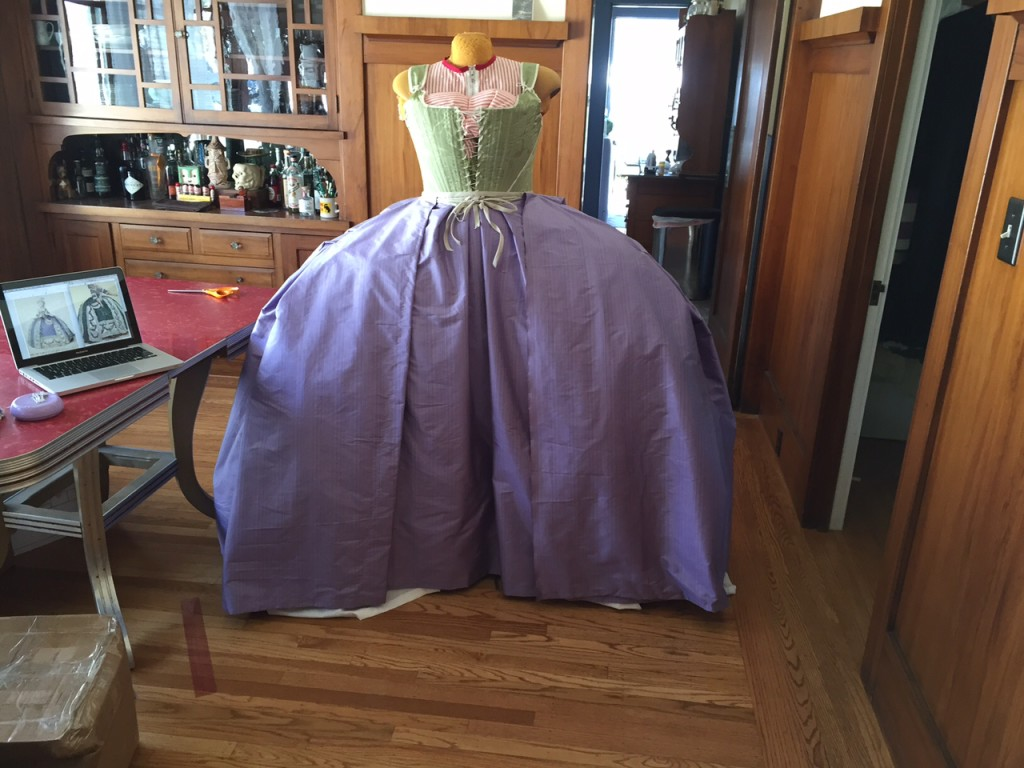 Mostly done overskirt/train. The left side opening is finished. I have to mess with the right to get the swoop/pull up.